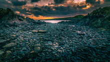 Isle Of Whithorn Pebbled Beach Set In A Dramatic Sunset