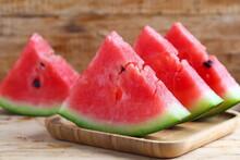 Fresh Sliced Watermelon On Wooden Background