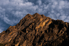 Landscape Of A Rocky Mountain Range Golden Toned With A Sunset Light