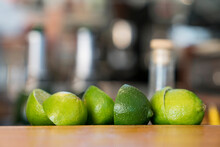 Row Of Cut Limes On Wood Count...