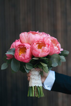 Groom's Hand With A Bouquet Ma...