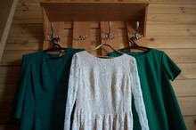 Three Dresses Hang On The Rack