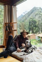 A Dalmatian Dog Sitting On A P...