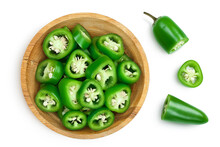 Sliced Jalapeno Pepper In Wooden Bowl Isolated On White Background. Green Chili Pepper With Clipping Path. Top View. Flat Lay