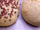 Fresh home baked breads, make out of wheat, one simple and one with pepperoni on top