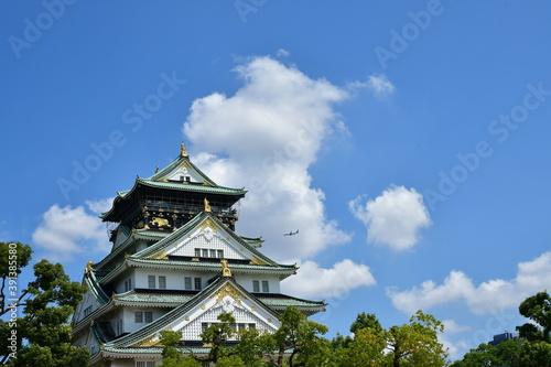 青空と大阪城上空を飛ぶ飛行機 Canvas