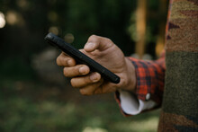 Black Hand Holding Smartphone ...