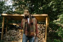 Black Man Getting Firewood For...