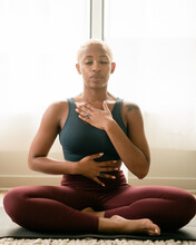Black Woman Breathing And Doing Meditation At Home