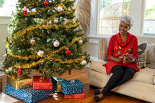 Grandmother On Smartphone Reading Holiday Text Messages