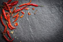 Dried Chili On Dark Background - Red Dried Chilli Pepper Cayenne On A Stone