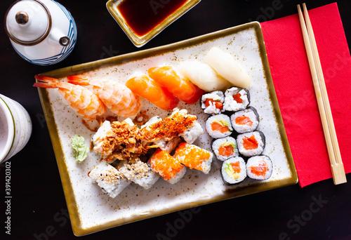 Fototapeta Delicious Japanese various sushi salmon maki and nigiri served on plate obraz