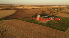 Aerial View Of American Countryside Landscape In Harvesting Season. Harvested Crop Field,  Farmhouse From Above. Midwestern USA