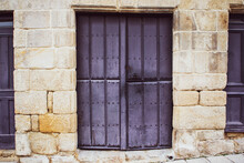 Violet Painted Wooden Door On Stone Frame