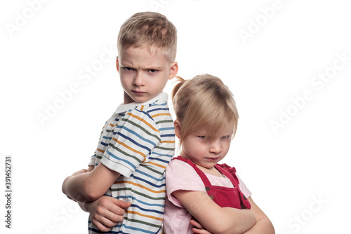 brother and sister are fighting on a white background Fototapet