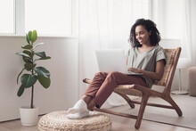 Young Woman Using Laptop Computer At Home. Student Girl Working In Her Room. Work Or Study From Home, Freelance, Business, Lifestyle Concept