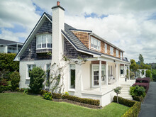 AUCKLAND, NEW ZEALAND - Oct 18, 2019: Suburban House With Chimney In Howick