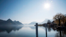 Beautiful Mood Of Autumn Foliage And Fog Lake In Morning With Boat Dock