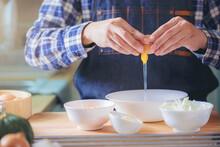 Chef Cracking Egg Into A Bowl ...