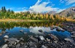 Alpine lake with reflections in Canadian Rocky Mountains. Alberta. Canada