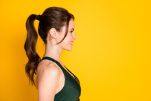 Close-up Profile Side View Portrait Of Attractive Sportive Cheerful Girl Fitness Isolated Over Bright Yellow Color Background