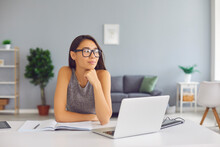 Creative Student, Writer Or Business Course Author Sitting At Desk With Laptop And Thinking