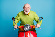 Photo Of Pensioner Carefree Grandpa Ride Motorcycle Crazy Expression Wear Eyeglasses Green Sweater Isolated Blue Color Background