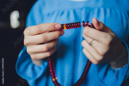 Religious Asian buddhist woman praying with hand holding rosary beads Fototapet