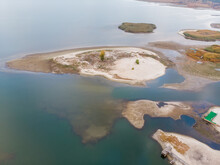 Scenic Aerial Drone Birds Eye View Of Swallow Sand River Or Lake Shore Due To Drought And Water Pond Reservoir Dam Draining. Natural Disaster Of Arid, Warmand Dry Climate Change