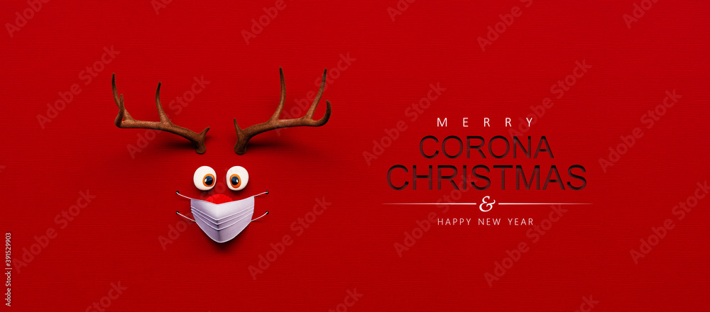 Fototapeta Reindeer toy with cold red nose and medical mask on red Christmas Corona background 3D Rendering