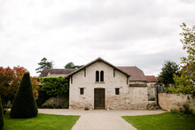 Old Stone Building Inside Garden In French Countryside