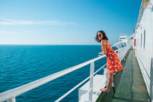 A Woman Is Sailing On A Cruise Ship