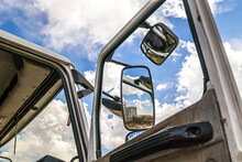 Mirror Of A Truck On A Background Of The Sky With Clouds