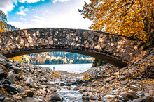 Stone Arched Bridge Over A Mou...