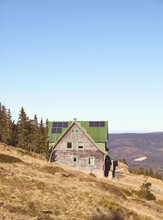 Retro Toned Picture Of Mountain Hut With Solar Panels On Roof.