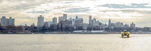 Brooklyn Cityscape Panoramic View. A Water Taxi Is Crossing The East River In Manhattan, New York City, USA
