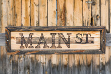 Old Weather Natural Weathered Wood Background With Main Street Sign