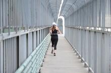 Jogging Woman. Runner On Jacques Cartier Bridge