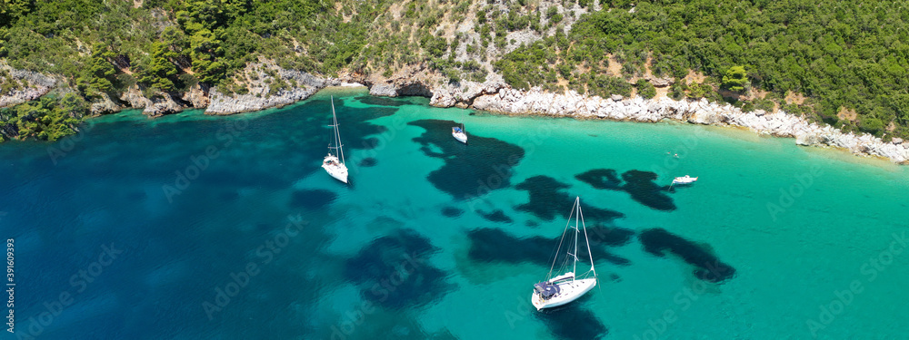Fototapeta Aerial drone ultra wide panoramic photo of tropical paradise deep turquoise lagoon with beautiful seascape in exotic destination island