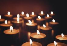 Bokeh. Candles On Dark Backgro...