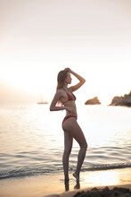 Gorgeous Woman In Backlight At A Beach