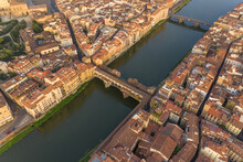 Aerial View Of Ponte Vecchio During Sunrise, Florence Italy.