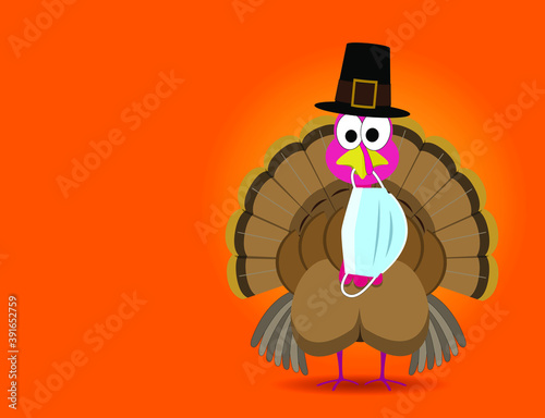 Fotografia Funny thanksgiving turkey wearing a pilgrim hat with a surgical face mask hangin