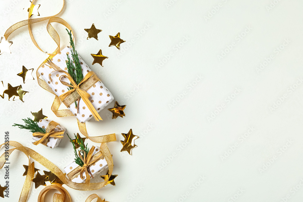 Fototapeta Christmas gift boxes with golden ribbon on white background, flat lay. Space for text