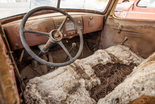 Old Car Steering Wheel And Rotten Seats.