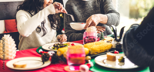 Fotografiet Portrait of happy big family celebrating having fun and eating food on lunch tog