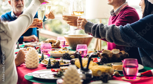 Obraz Portrait of happy big family celebrating having fun and lunch together,drinking red wine and clinking glasses enjoying spending time together at home - fototapety do salonu