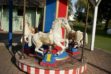 Closeup Shot Of White Horses On A Children's Carousel
