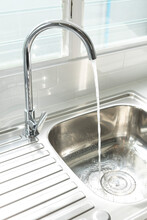Water Flows From A Faucet Into...