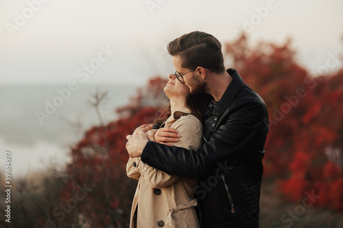Fotografiet Loving young couple is hugging, at nature